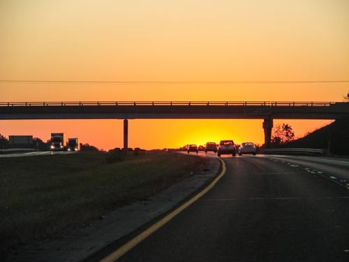 A sunset over the highway