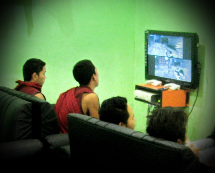 Monks playing video games in McLeod Ganj, India