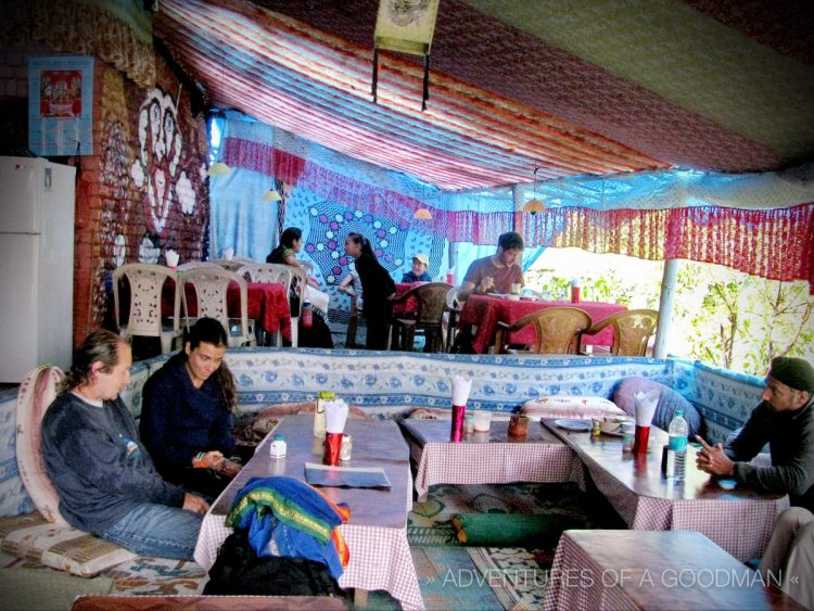 Tourists relax and eat inside the Munchies Cafe in Bahgsu, India