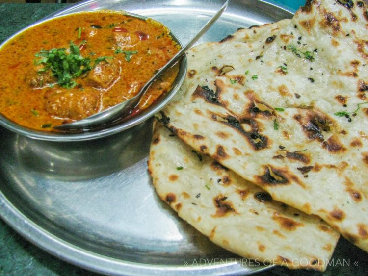 Butter Chicken and garlic naan in Rishikesh, India