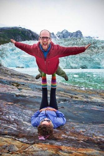 My wife, Carrie, puts me up in an Acro Yoga pose on the Pia Glacier.