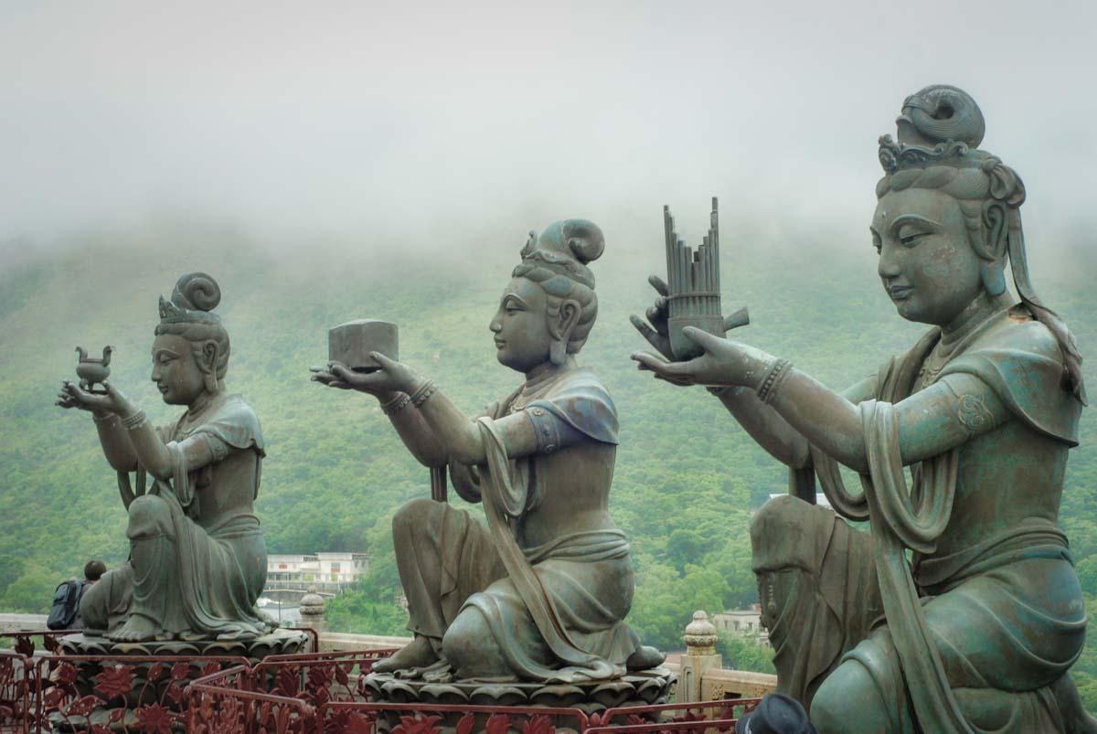 Statues present offerings to the gods on Lantau Island