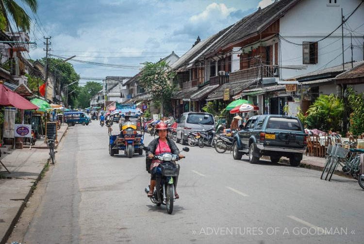 A motorcycle ... amongst other vehicles ... on the streets of Louang Phabang, Laos