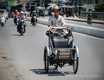 A cyclo taxi driver on the streets of Da Lat, Viet Nam