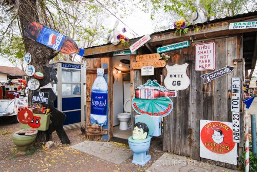 An assortment of old signs and toilet bowls outside Delgadillo's Snow Cap Drive-In, Seligman, Arizona - Route 66
