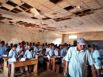 A headmaster tends his classroom in Madagascar, Africa