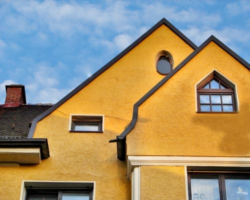 Symmetrical triangles of traditional Bavarian houses in Augsburg, Germany