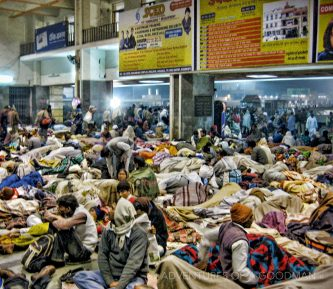 Hundreds of people sleep on the floor while stranded overnight in a Varanasi train station