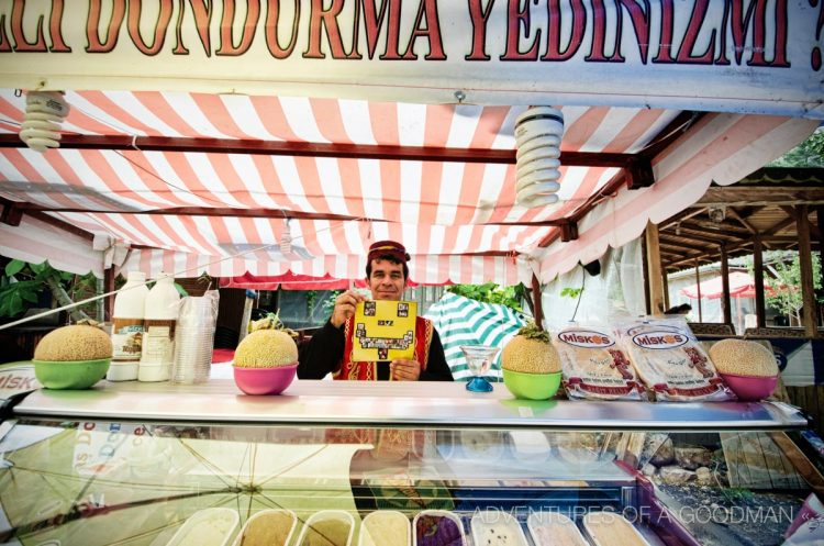 Huiseyin Tekin holds up a piece of the Symmetry Project at his ice cream stand in Olympos, Turkey