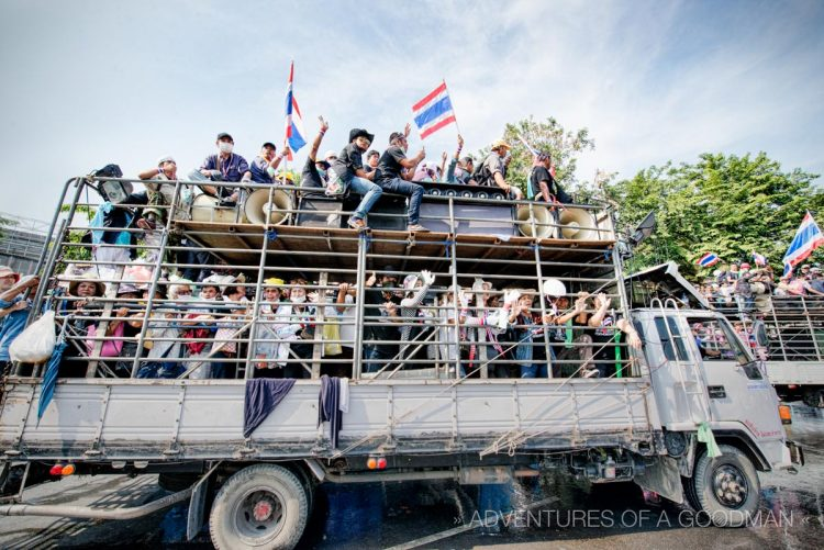 Bangkok's anti-government protesters move around town on giant trucks