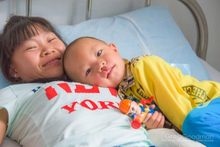 Mama and her baby recover from surgery - Alliance for Smiles - Mission to XingYi, China