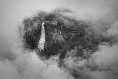 A ring of fog surrounds Nevada Falls in Yosemite National Park, as seen from Glacier Park