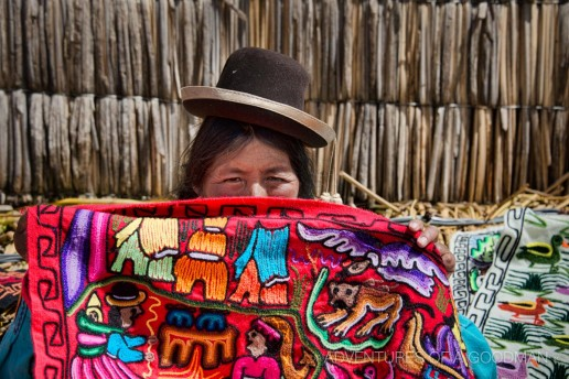 A Peruvian blanket vendor on the Uros Islands on Lake Titicaca, Peru