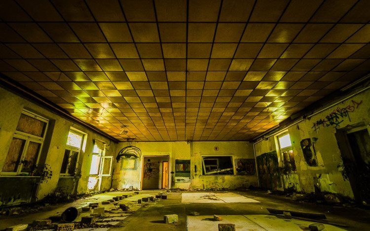 """""""As much as I've spent the past few years around ruins dating hundreds or thousands of years old, it's the more modern abandoned places that catch my interest. The interior glows yellow and green thanks to light filtered through the trees around an abandoned building in a former railway complex outside of Berlin, Germany."""""""