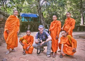 Hanging out with monks at Ta Phrom in Angkor, Cambodia
