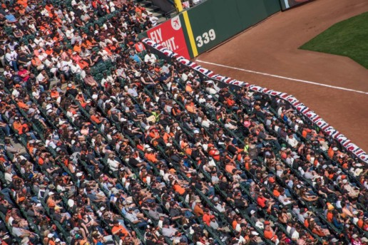 Fans in the left field watch the SF Giants play ball!