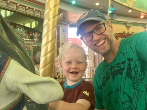 Dada and Bodhi on the carousel at the Santa Cruz Beach Boardwalk